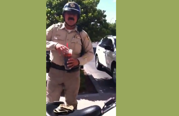 Watch a 12-Year-Old Confront a Cop for Parking His Motorcycle on the Sidewalk