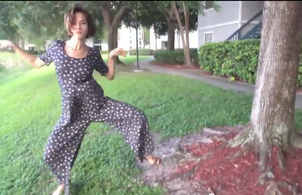 Woman is way too excited about her new pantsuit